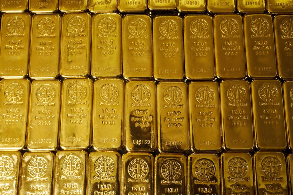 Dozens of 1 kg gold bars laid side by side